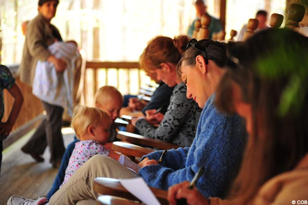 Community of Caritas writing petitions before apparition